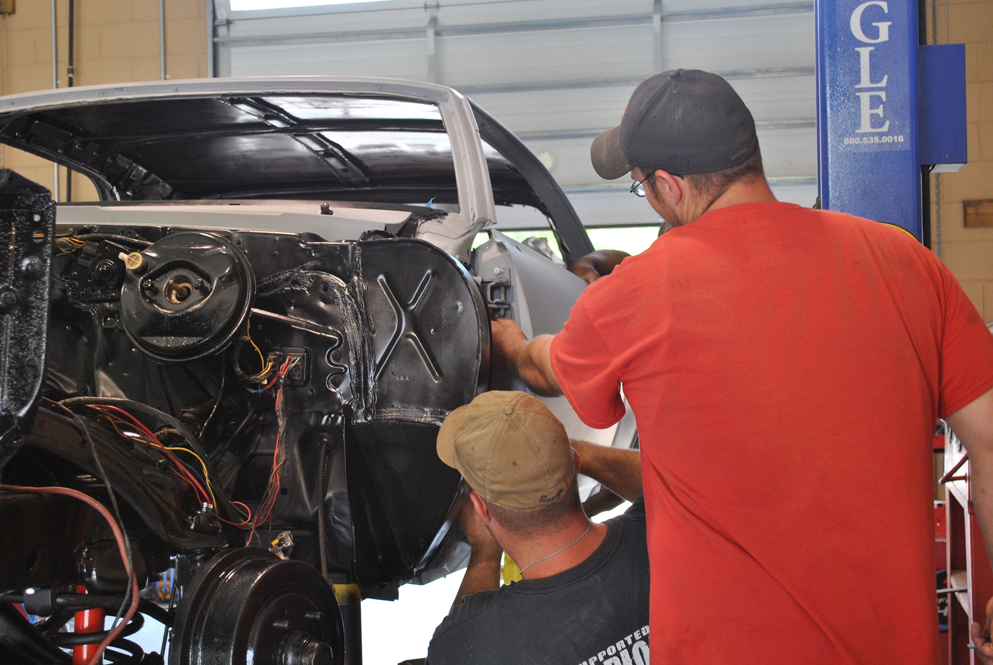 Students working on a car